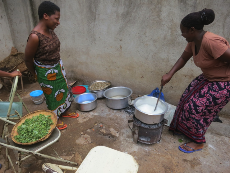 Photo: Students fixing a meal of ugali, dagaa and greens