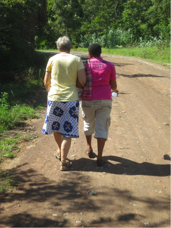 Photo: Paschalina and Linda walking to the dala dala stop for our return to Moshi