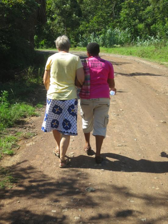 Photo: Paschalina and Linda walking to the dala dala stop for our return to Moshi