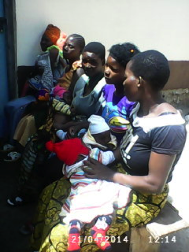 Photo: Mothers and children at the monthly clinic visit