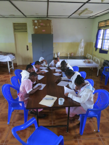 Tukuyu students completing application form