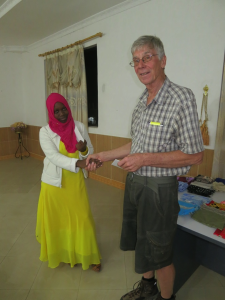 Aisha receiving an academic award
