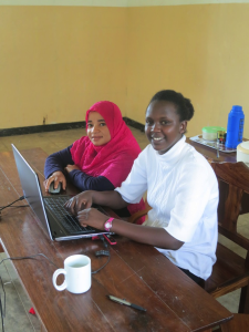 Zuena and Tikakoi working on PPT presentation
